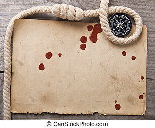 compass, rope and old paper