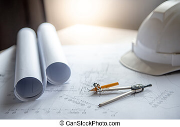 compass tool, blueprints and helmet on working table