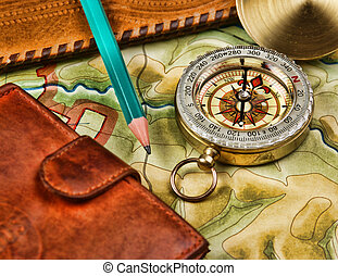 compass wallet and passport on the old map