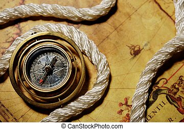 Compass with rope on the old map