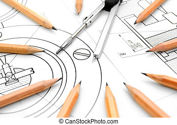Compasses and pencils on the drawing.