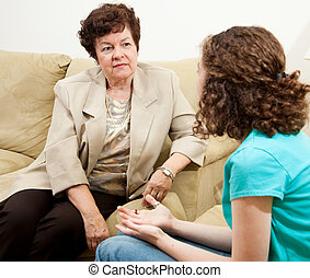 Compassionate Counselor - Counselor listening with sympathy...