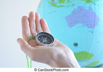 compasso, globo, austrália, segurando mão