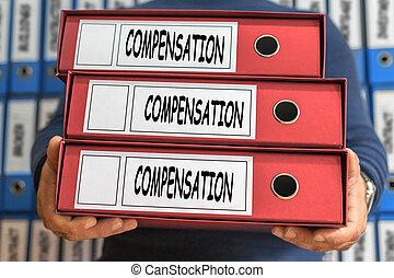 Compensation concept words. Folder concept. Ring binders.