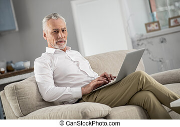 Competent businessman working at home
