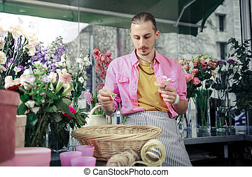 Competent young designer working in floral shop