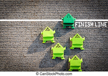 Competition in business concept with jumping frogs