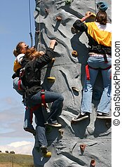 Teen girls climbing the rock wall