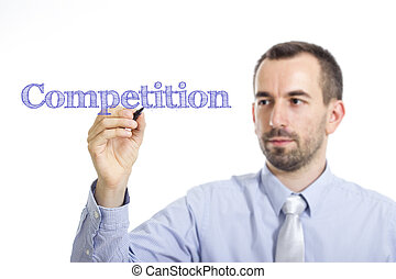Competition - Young businessman writing blue text on transparent surface