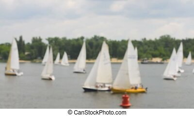 Competitions on yacht regatta blurred