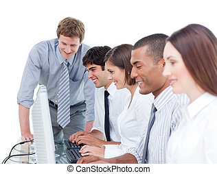 Competitive business team working at a computer