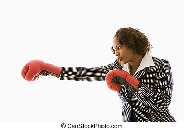 Competitive businesswoman. - Businesswoman wearing boxing...