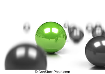 competitive edge and business difference concept, many grey balls and one green sph?re onto a white background with movement effect and blur.