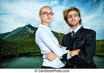 competitive - A businessman standing with his colleague...