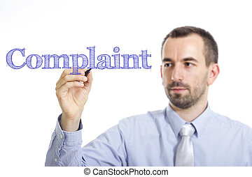 Complaint - Young businessman writing blue text on transparent surface
