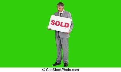 complet, gris, signe, homme affaires, vendu