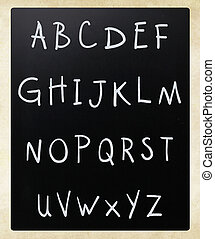 Complete english alphabet handwritten with white chalk on a blackboard