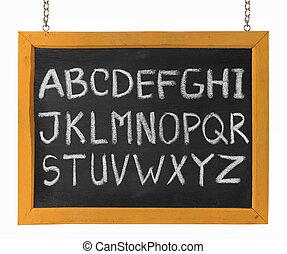 letters of English alphabet capital upper case on blackboard...