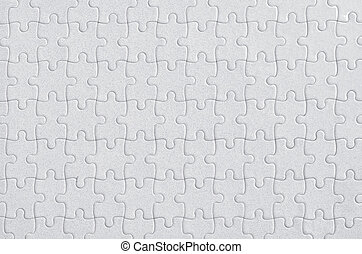 Completed blank jigsaw puzzle as copy space background, top view full frame image