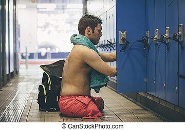 Completed Swimming Session - Quadriplegic athlete getting...