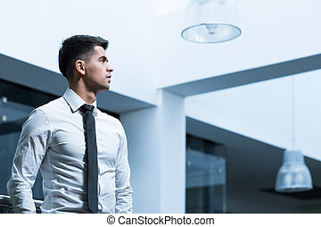 Completely focused on a task - Young, elegant businessman in...