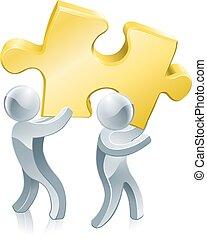 Completing jigsaw teamwork