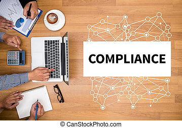 COMPLIANCE Business team hands at work with financial ...