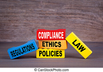 Compliance concept. Colored wooden blocks on the table