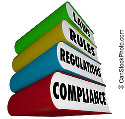 Compliance, Laws, Rules and Regulations words on a stack of books to illustrate the vast amount of guidlines to follow to comply with business and governmental practices