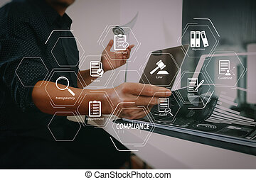 Compliance Virtual Diagram for regulations, law, standards, requirements and audit. businessman working with smart phone and digital tablet and laptop computer and document in modern office