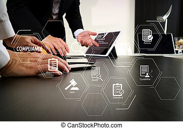 Compliance Virtual Diagram for regulations, law, standards, requirements and audit. co working team meeting concept, businessman using smart phone and digital tablet and laptop computer in modern office