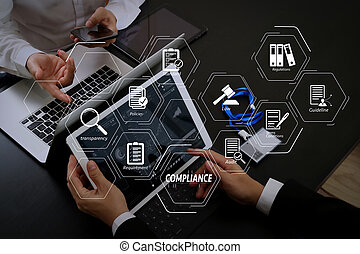 Compliance Virtual Diagram for regulations, law, standards, requirements and audit. co working team meeting concept, businessman using smart phone and digital tablet and laptop computer and name tag in modern office