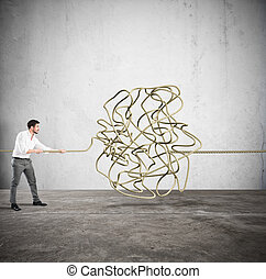 Complicated tangle - Businessman trying to solve the...