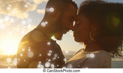 Complicity moment on beach between a Mixed-race couple