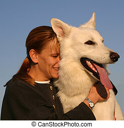 complicity - woman and her purebreed white german shepherd