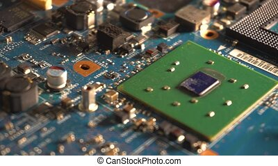 Components of the computer motherboard. Dolly shot over...