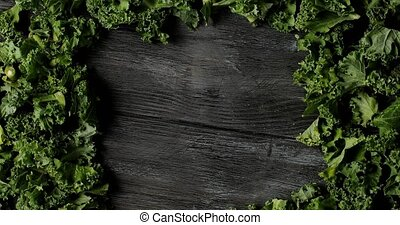 Composed green salad leaves on wood - From above shot of...