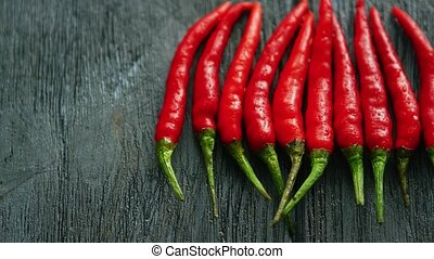 Composed row of red chili peppers - From above shot of...