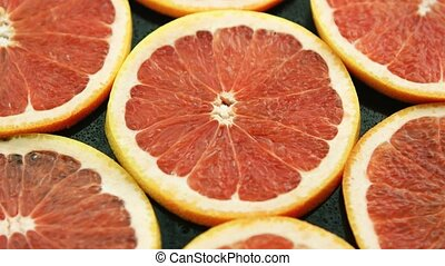 Composed slices of red grapefruit - Closeup of composed...