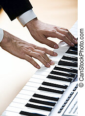 Composing - Isolated on pink human hands playing the piano