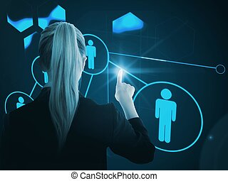 Composite image of a businesswoman pointing somewhere on glowing futuristic blue background