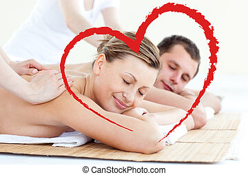 Composite image of affectionate couple having a back massage...