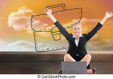 Composite image of attractive blonde businesswoman sitting in front of laptop with arms up