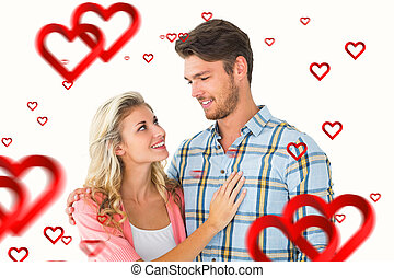 Composite image of attractive young couple smiling at each other