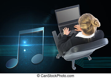 Composite image of blonde businesswoman sitting on swivel ...