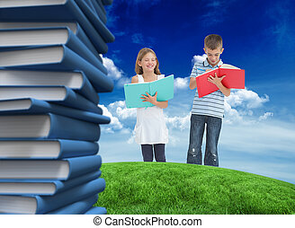 Composite image of brother and sister doing their homework toget
