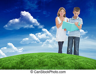 Composite image of brother and sister learning their lesson toge