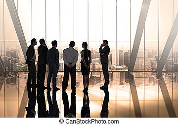 Composite image of business colleagues talking in large room...