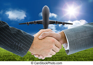 Composite image of business handshake against 3d plane ...