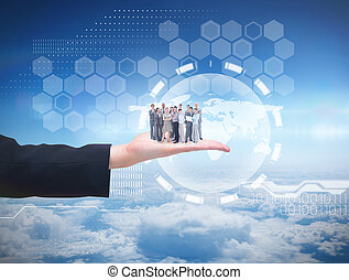 Composite image of business team looking at camera -...